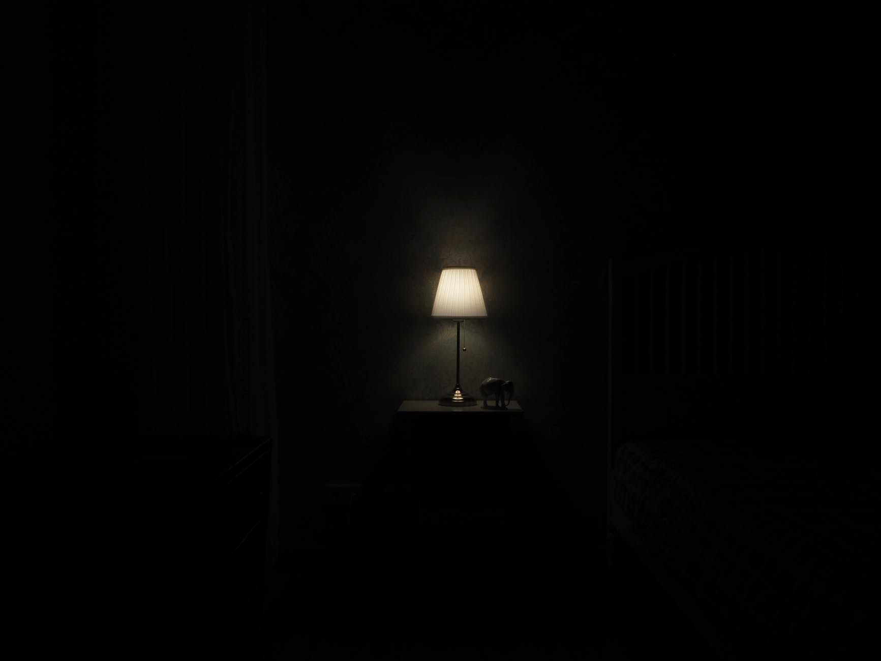 turned on grey table lamp