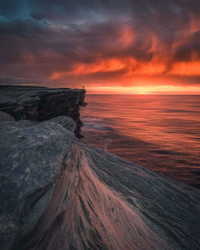 grey cliff beside ocean
