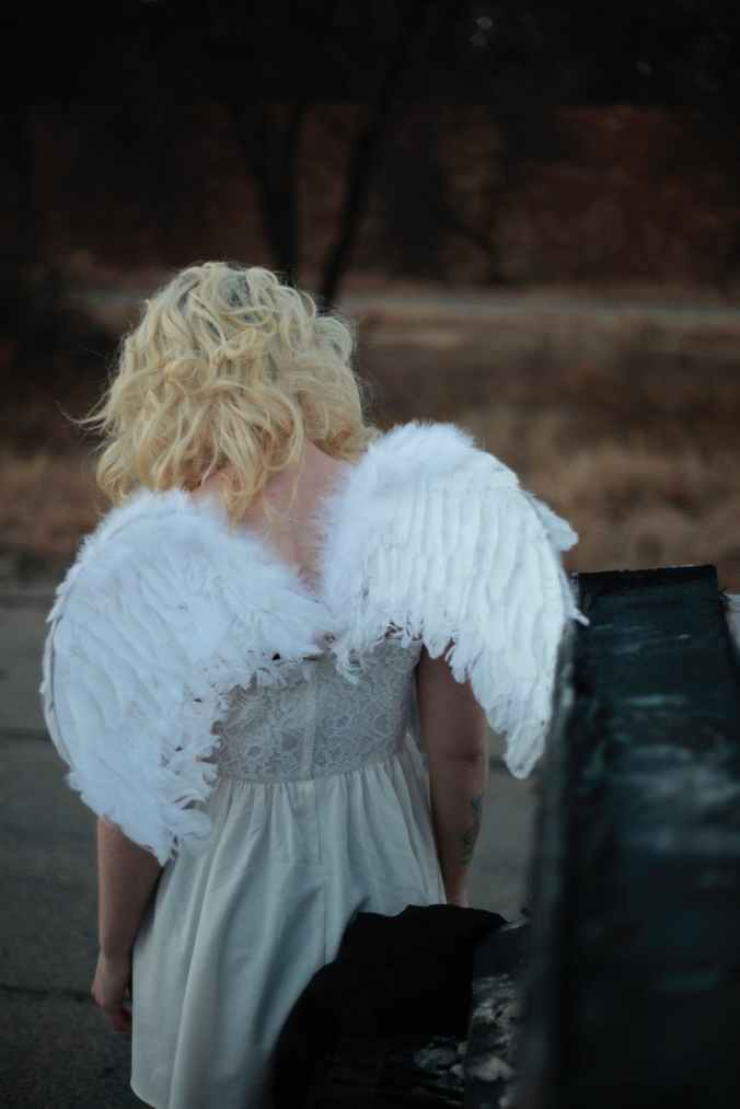 woman wearing wings